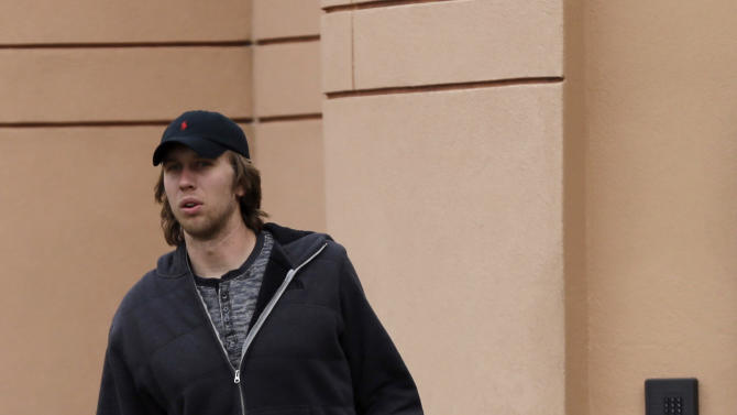 Philadelphia Eagles' Nick Foles walks out of the team's NFL football training facility, Monday, Dec. 31, 2012, in Philadelphia. The Eagles had a season-ending 42-7 loss to the New York Giants on Sunday, and head coach Andy Reid was fired Monday. (AP Photo/Matt Rourke)