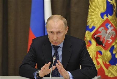Russian President Putin speaks during a meeting with economic advisors at the Bocharov Ruchei state residence in Sochi
