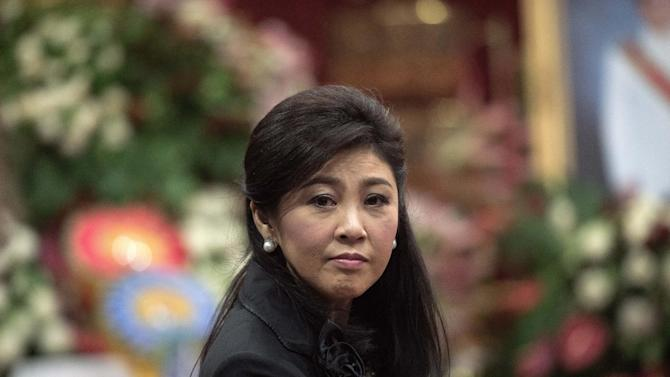 Ousted Thai prime minister Yingluck Shinawatra at a funeral in a Buddhist temple in Bangkok. The Red Shirts backed her toppled government