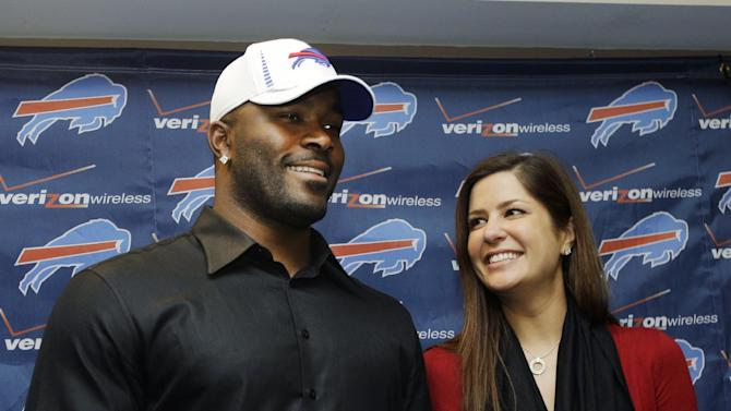 Buffalo Bills' Mario Williams poses for a photo with his fiance' Erin Marzouki after an NFL football news conference in Orchard Park, N.Y., Thursday, March 15, 2012. Williams signed a contract touted as the richest ever given to an NFL defensive player _ a deal worth up to $100 million with $50 million guaranteed, according to his agent, Ben Dogra. (AP Photo/David Duprey)