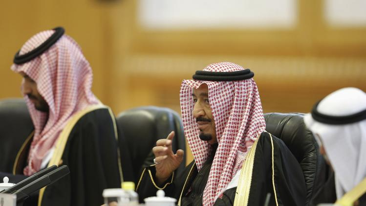 Saudi Arabia's Crown Prince Salman Bin Abdulaziz Al Saud reacts during a meeting with China's President Xi Jinping at the Great Hall of the People in Beijing