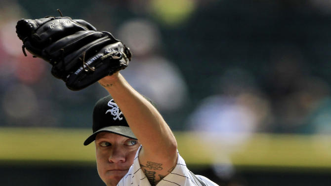 FILE - Chicago White Sox starting pitcher Jake Peavy throws to a Minnesota Twins batter during the first inning of a baseball game, in this Sept. 5, 2012 file photo taken in Chicago. The Boston Red Sox have acquired Peavy from the Chicago White Sox in a three-team deal that also sent shortstop prospect Jose Iglesias to Detroit Tigers. (AP Photo/John Smierciak, File)