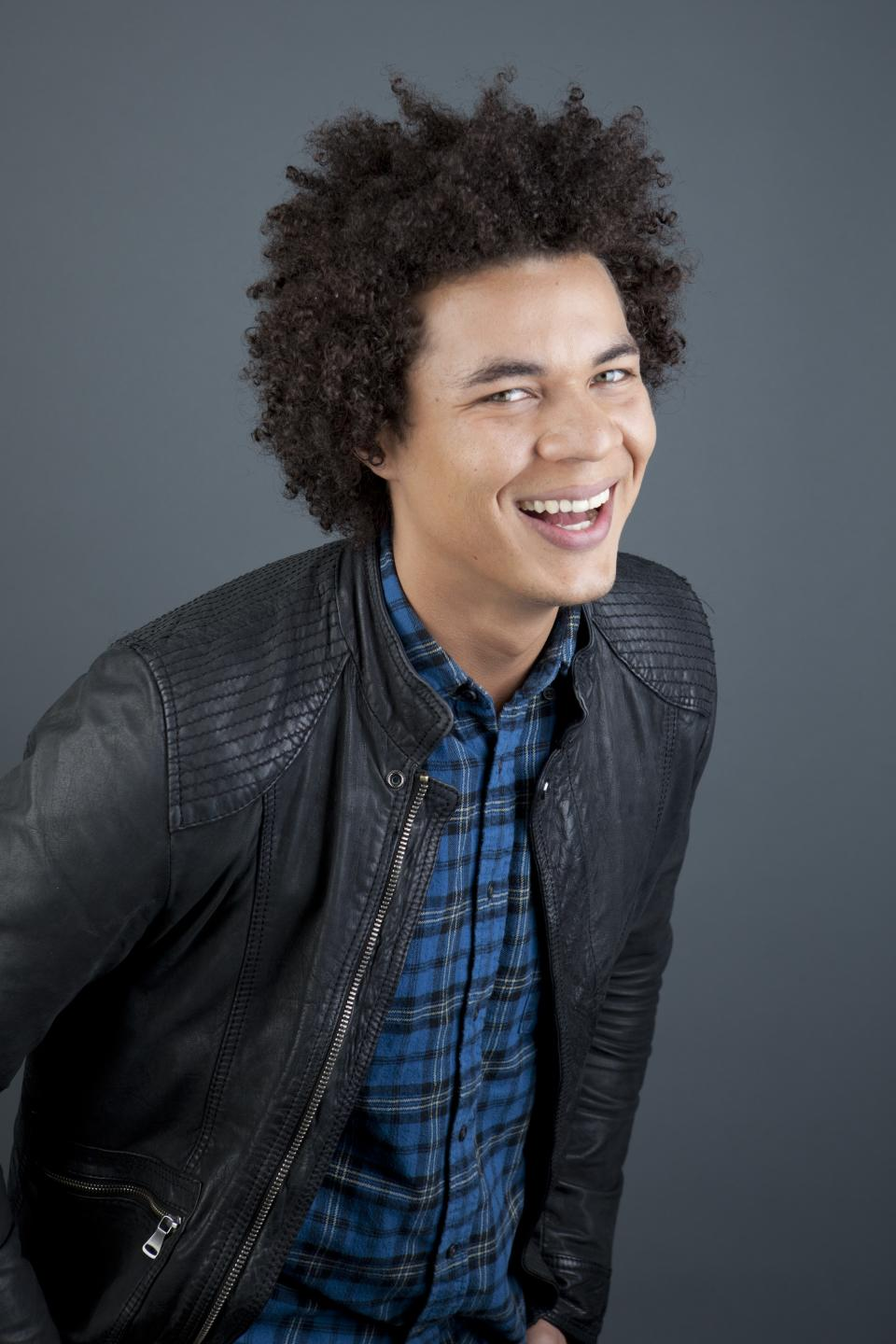 "This April 30, 2013 photo shows  Puerto Rican actor Ismael Cruz Cordova, 26, of ""Sesame Street,"" posing in New York.  Cruz plays Mando, a young Latino writer who interacts with the puppets and also loves technology. (Photo by Amy Sussman/Invision/AP)"