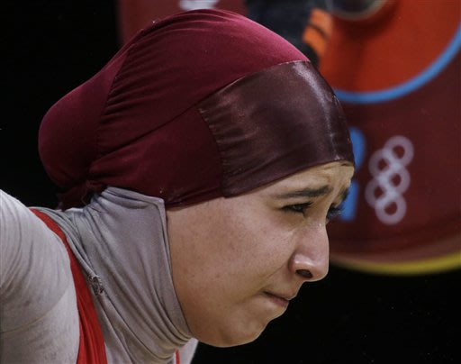 Tunisia weightlifter competes in full-body uniform
