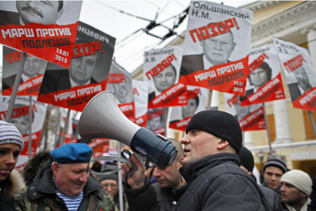 Opposition leader Sergei Udaltsov, foreground, speaks during a protest rally in Moscow, Russia, Sunday, Jan. 13, 2013. Thousands of people are gathering in central Moscow for a protest against Russia'