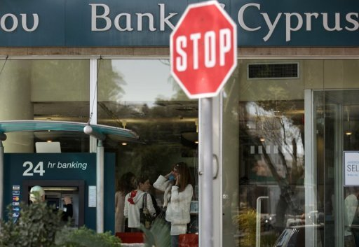 People queue for transactions at a Bank of Cyprus branch in central Nicosia on April 10, 2013. Charities, private schools and insurance firms with deposits in the troubled Bank of Cyprus will suffer a 27.5% haircut under the island's EU bailout, the central bank said.