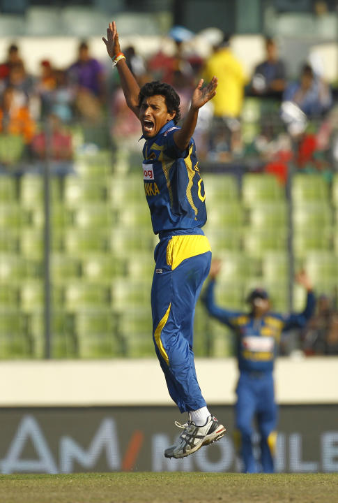 Sri Lanka's Suranga Lakmal appeals unsuccessfully for a Pakistani wicket during their Asia Cup final cricket match in Dhaka, Bangladesh, Saturday, March 8, 2014. (AP Photo/A.M. Ahad)