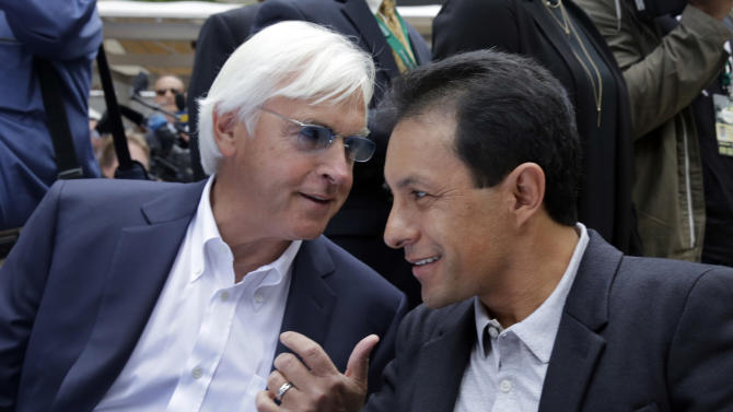 Trainer Bob Baffert, left, and jockey Victor Espinoza, for American Pharoah, huddle during the post position draw for the 147th Belmont Stakes at New York's Rockefeller Center, Wednesday, June 3, 2015. American Pharoah was made the early 3-5 favorite on Wednesday to win the Belmont Stakes and become U.S. horse racing's first Triple Crown winner in 37 years. (AP Photo/Richard Drew)