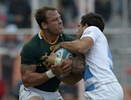 South Africa's scrum half Francois Hougaard (L) is tackled by Argentina's scrum half Nicolas Vergallo during their Rugby Championship second round match at Malvinas Argentinas stadium in Mendoza, some 1050 km west of Buenos Aires, Argentina. The match ended in a 16-16 draw