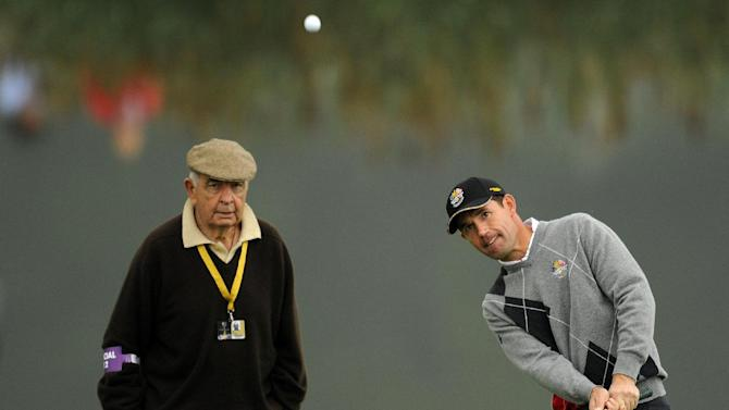 Europe Ryder Cup player Padraig Harrington (R) is watched by coach Bob Torrance during a practice session at Celtic Manor golf course in Newport, Wales on September 28, 2010