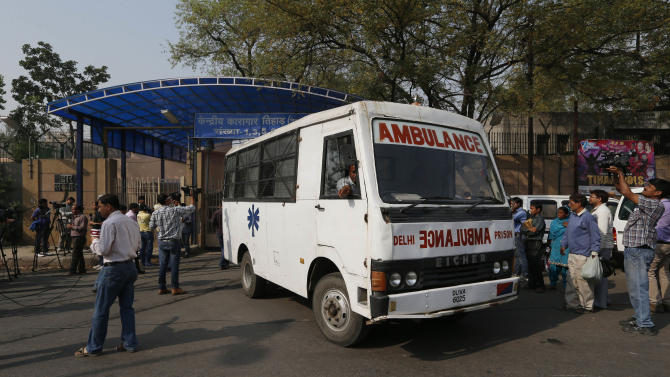An ambulance comes out as media persons stand outside the Tihar Jail, the largest complex of prisons in South Asia, in New Delhi, India, Monday, March 11, 2013. Indian police confirmed that Ram Singh, one of the men on trial for his alleged involvement in the gang rape and fatal beating of a woman aboard a New Delhi bus committed suicide at the Tihar jail Monday, but his lawyer and family allege he was killed. (AP Photo/Saurabh Das)