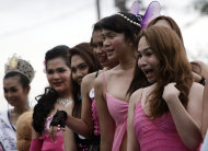 A group of gays take part in the annual Pride March in Manila, Philippines, Saturday, Dec. 3, 2011. Lesbians, gays, bisexual and transgenders called for the urgent need to pass the anti-discrimination bill and for government protection from hate crimes committed against them. (AP Photo/Pat Roque)