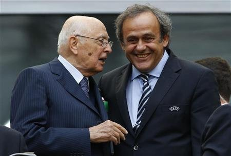 Italian President Giorgio Napolitano (L) speaks to UEFA President Michel Platini before the start of Group C Euro 2012 soccer match between Spain and Italy at the PGE Arena stadium in Gdansk, June 10, 2012.