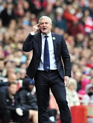 File picture. Mark Hughes is under increasing pressure at QPR, who are bottom of the table after Charlie Adam claimed his first goal for Stoke City to give Tony Pulis&#39; side a 1-0 win at home over the Londoners