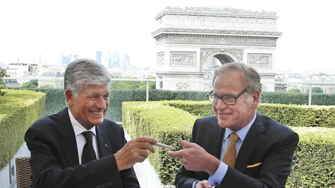 "FILE - This Sunday, July 28, 2013, file photo shows Maurice Levy, left, Chief Executive of French advertising group Publicis, and John Wren, head of Omnicom Group exchanging a pencil during a joint signature prior to a news conference in Paris, France. The CEO of Publicis Groupe, Maurice Levy, says the planned deal with Omnicom to create the world's largest advertising firm collapsed over unresolvable differences over how to implement a ""merger of equals."" The merger announced in July was intended to help the firms counter the growing clout of Internet giants such as Facebook and Google, which can bypass advertising companies altogether, as well as strengthen growth in Asia and Latin America. (AP Photo/Francois Mori, File)"
