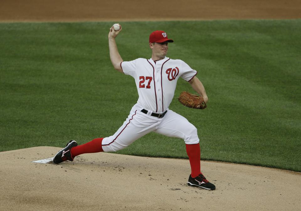 Washington Nationals starting pitcher Jordan Zimmermann delivers a pitch against the Milwaukee Brewers, during the first inning of a baseball game at Nationals Park, Monday, July 1, 2013, in Washington. (AP Photo/Pablo Martinez Monsivais)