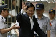 Taiwan&#39;s former president Chen Shui-bian waves as he arrives at the High Court in Taipei in 2010. Taiwan&#39;s Supreme Court on Thursday quashed a successful appeal by Chen against one of his corruption convictions, ordering the High Court to review the high-profile case