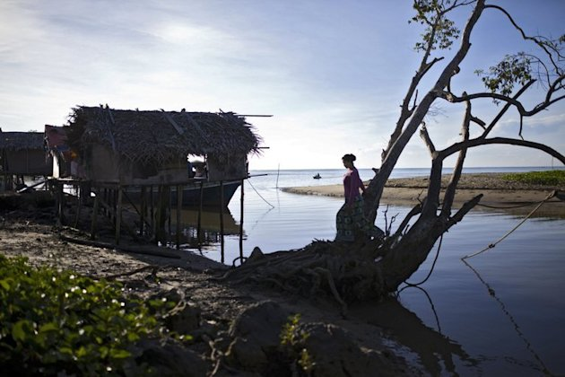 A resident walks in Tanjung Labian, near where Philippine militants have staked a territorial claim on February 21, 2013