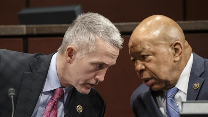 FILE - In this Jan. 27, 2015, file photo, the House Select Committee on Benghazi Chairman Rep. Trey Gowdy, R-S.C., left, confers with Rep. Elijah Cummings, D-Md., the ranking member on Capitol Hill in Washington at the start of the panel's third public hearing to investigate the 2012 attacks on the U.S. consulate in Benghazi, Libya, where a violent mob killed four Americans, including Ambassador Christopher Stevens. A special House committee on the 2012 Benghazi attacks has devolved from an investigation into the deaths of four Americans in Libya into a political fight over Hillary Rodham Clinton's emails and private computer servers, in a battle that is likely to stretch into the 2016 presidential election year.  (AP Photo/J. Scott Applewhite, File)