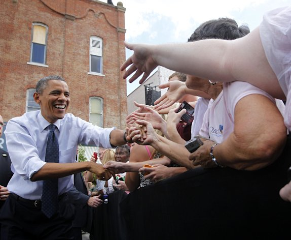 President Barack Obama greets supporters at a campaign event at Mansfield Central Park, Wednesday, Aug. 1, 2012 in Mansfield, Ohio. Obama is campaign in Ohio with stops in Mansfield and Akron today. (AP Photo/Pablo Martinez Monsivais)