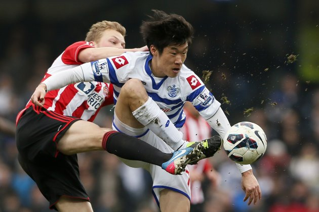 Queens Park Rangers' Park challenges Sunderland's Larsson during their English Premier League soccer match in London