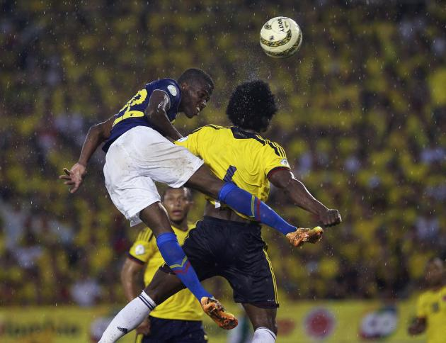 Ecuador's Enner Valencia and Colombia's Carlos Moreno jump as they challenge for the ball during a 2014 World Cup qualifying soccer match in Barranquilla