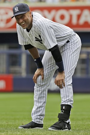 New York Yankees' Derek Jeter warms up before a baseball …