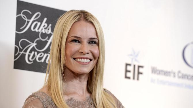 """FILE - In this May 2, 2013 file photo, Chelsea Handler arrives at """"An Unforgettable Evening"""" benefiting EIF's Women's Cancer Research Fund at The Beverly Wilshire in Beverly Hills, Calif. Handler drew accusations of racism Sunday night, March 2, 2014, after she took over The Huffington Post's Twitter account for several hours and repeatedly touted her upcoming book, """"Uganda Be Kidding Me,"""" whenever """"12 Years A Slave"""" received an Academy Award. (Photo by Dan Steinberg/Invision/AP, file)"""
