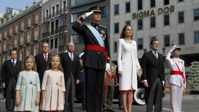 Spain's new King Felipe VI, his wife Queen Letizia, Princess Leonor and Princess Sofia arrive at the Congress of Deputies to attend the swearing-in ceremony in Madrid