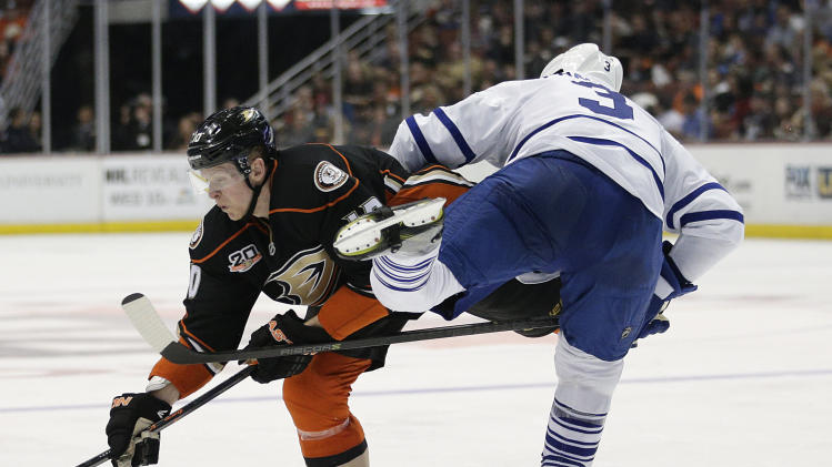 Anaheim Ducks' Corey Perry, left, collides with Toronto Maple Leafs' Dion Phaneuf during the second period of an NHL hockey game on Monday, March 10, 2014, in Anaheim, Calif. (AP Photo/Jae C. Hong)