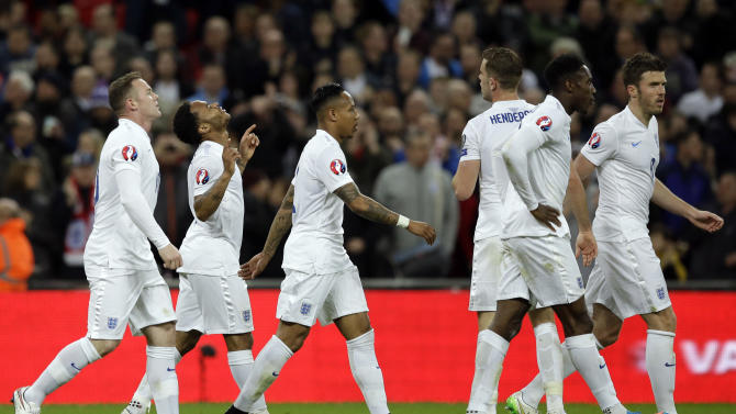 England's Raheem Sterling, second left, celebrates his goal with his teammates  during the Euro 2016 Group E qualifying soccer match between England and Lithuania at Wembley Stadium in London, Friday, March 27, 2015. (AP Photo/Matt Dunham)