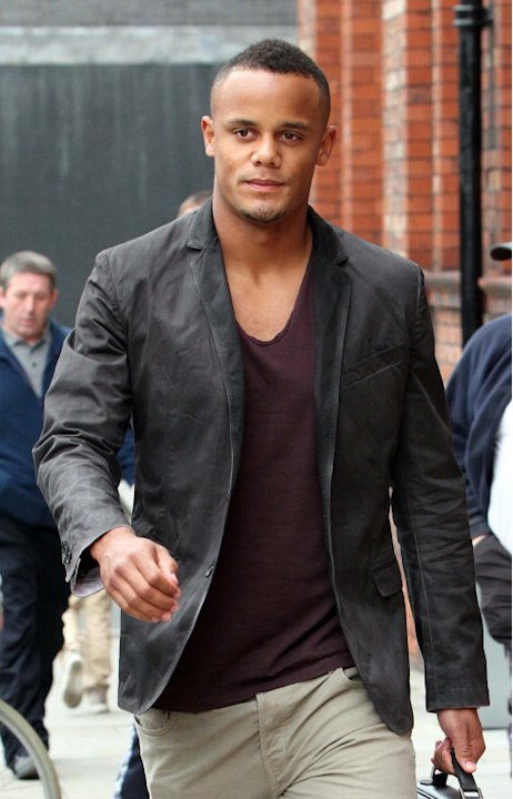 Manchester City captain Vincent Kompany leaves the Great John Street hotel in Manchester, UK