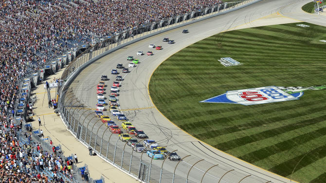 Jimmie Johnson (48) and Aric Almirola (43) lead the field at the start of  the NASCAR Sprint Cup Series auto race at Chicagoland Speedway in Joliet, Ill., Sunday, Sept. 16, 2012. (AP Photo/Warren Stewart)