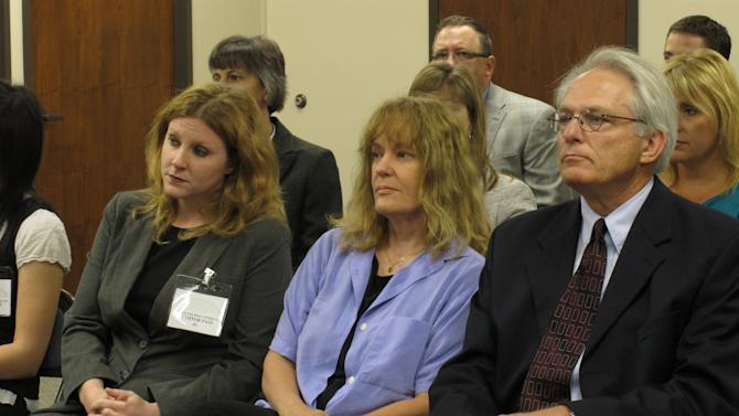 Dr. Ann Kristin Neuhaus, center, sits between two of her attorneys, Kelly Kauffman, left, and Bob Eye, right, as the Kansas State Board of Healing Arts decides to revoke her medical license, Friday, June 22, 2012, in Topeka, Kan. The board board acted in response to allegations concerning referrals of young patients by Neuhaus to the late Dr. George Tiller for late-term abortions. (AP Photo/John Hanna)