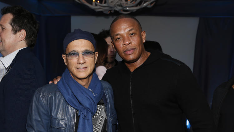 Jimmy Iovine and  Dr. Dre attend a Grammy Party hosted by Lucian Grainge on Sunday, Feb. 10, 2013 in Los Angeles. (Photo by Todd Williamson/Invision/AP)