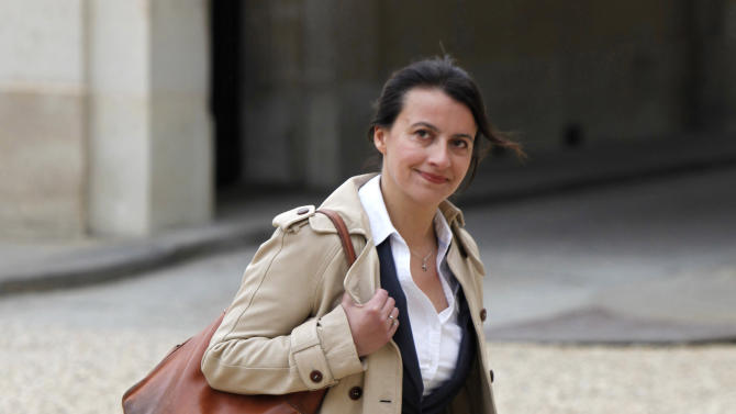 FILE - In this May 17, 2012 file photo newly named Housing Minister Cecile Duflot, wearing denim trousers, arrives for the first weekly cabinet meeting with new President Francois Hollande, at the Elysee Palace in Paris. France's prime minister has organized for all his ministers to be given anti-sexism lessons _ following one minister's comments by that women couldn't get their head round technical work. Earlier this year, Duflot was hooted at by her male colleagues when she took to the podium at the French parliament for wearing a floral dress back in July. (AP Photo / Thibault Camus, File)