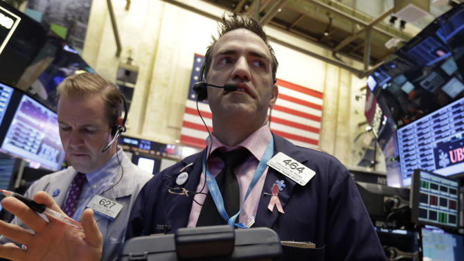 Trader Michael Smyth, left, and Gregory Rowe work on the floor of the New York Stock Exchange, Thursday, May 2, 2013. Stocks are opening higher on Wall Street, a day after the market's biggest fall in two weeks, after General Motors and other big companies announced higher profits. (AP Photo/Richard Drew)