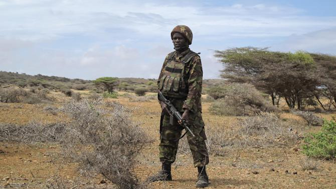 A Kenyan soldier provides security at the airport in Kismayo, in southern Somalia Tuesday, Oct. 2, 2012. Allied African troops have taken full control of Kismayo in Somalia, the last stronghold of al-Shabab Islamist rebels who have been fighting against the country's internationally backed government, a Kenyan military official said Tuesday, and Kenya Defence Forces and the Somali National Army are now patrolling the streets. (AP Photo/Josphat Kasire)