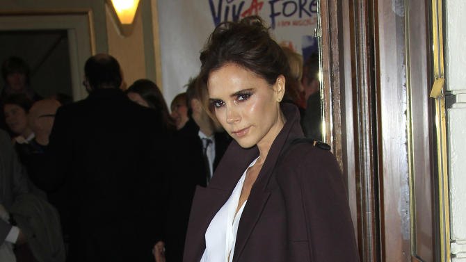 Victoria Beckham arrives for the press viewing of Viva Forever!, a musical based on the songs of the Spice Girls, at a theater in central London, Tuesday, Dec. 11, 2012. (Photo by Joel Ryan/Invision/AP)