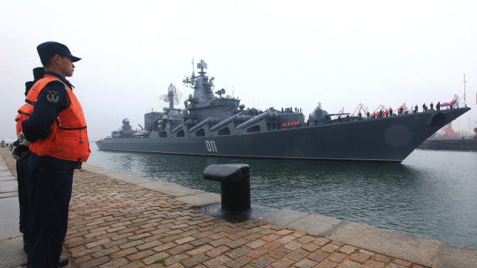 In this photo released by China's Xinhua News Agency, Russian Pacific Fleet's flagship Varyag, a Slava-class guided missile cruiser, arrives at a naval base in Qingdao, east China's Shandong Province, Saturday, April 21, 2012. A China-Russia joint maritime drill is scheduled from April 22 to 27 on the Yellow Sea, Xinhua said. (AP Photo/Xinhua, Zha Chunming) NO SALES