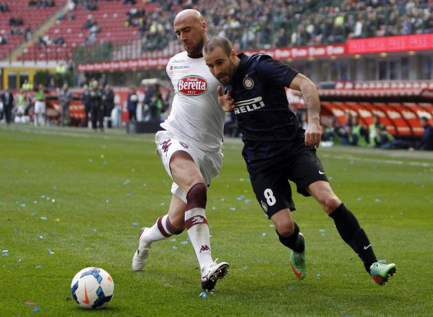 Inter Milan's Palacio fights for the ball with Torino's Rodriguez during their Italian Serie A soccer match in Milan