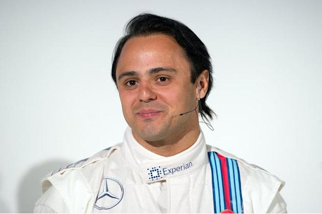 Brazilian Formula One driver Felipe Massa poses for photographs during the 2014 Wiliams F1 team launch in London on March 6, 2014