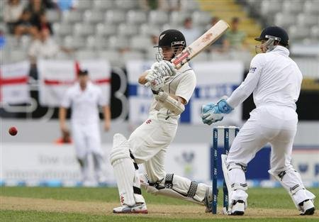 Williamson of New Zealand plays a shot as England's Prior watches during day one of the final cricket test at Eden Park in Auckland
