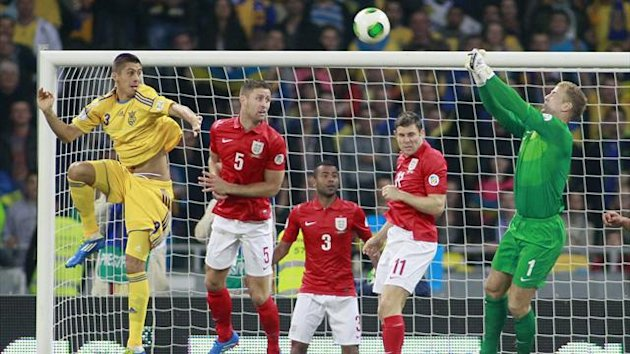 Ukraine's Yevhen Khacheridi (L) goes for a header with England's goalkeeper Joe Hart (R), James Milner (2nd R), Ashley Cole (3rd R) and Gary Cahill during the 2014 World Cup qualifying soccer match at the Olympic stadium in Kiev (Reuters)