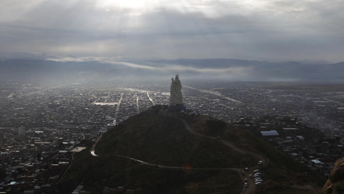 "A large statue of the Virgin Mary stands on Santa Barbara hill overlooking the mining city of Oruro, Bolivia, as it is unveiled on Friday, Feb. 1, 2013. The statue, known in Spanish as ""Virgen del Socavón,"" or the Virgin of the Tunnel, is Oruro's patron, venerated in particular by miners and folkloric Carnival dancers. To withstand Bolivia's high plains' strong winds, the statue that stands at 45 meters (147 feet) was constructed with cement, metal and fiberglass. (AP Photo/Juan Karita)"