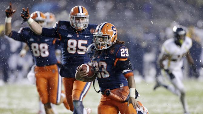 Syracuse wide receiver Jarrod West (88) and tight end Beckett Wales (85) begin to celebrate as running back Prince-Tyson Gulley (23) runs for a second-quarter touchdown against West Virginia during the Pinstripe Bowl NCAA college football game at Yankee Stadium in New York, Saturday, Dec. 29, 2012. (AP Photo/Kathy Willens)