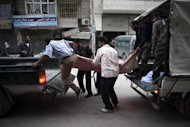 Syrians transport a victim in the northern city of Aleppo on October 21. Hopes of a truce being implemented in war-torn Syria during this week&#39;s Muslim Eid holidays are &quot;slim,&quot; the Arab League said on Monday, as rebels and troops engaged in fierce clashes in Damascus and on northern battlefields