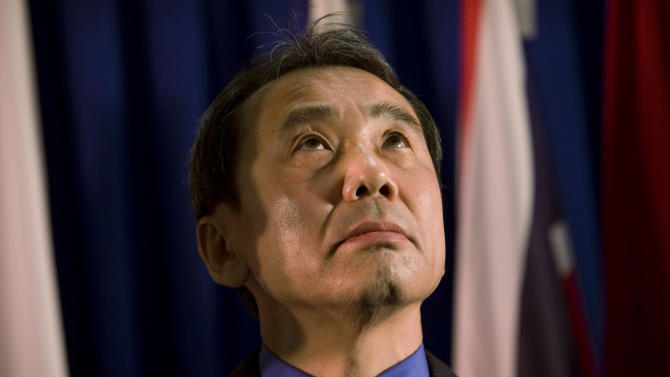 """FILE - In this Feb. 15, 2009 file photo, novelist Haruki Murakami of Japan reacts before receiving the Jerusalem award during the International Book Fair in Jerusalem. Murakami said Monday, May 6, 2013 his latest novel was a new experiment and grew longer than expected as he developed a desire to expand on side characters while writing. The latest novel by one of Japan's most respected and popular novelists, """"Colorless Tsukuru Tazaki and the Year of His Pilgrimage,"""" has sold more than 1 million copies a week since it went on sale last month. (AP Photo/Bernat Armangue, File)"""