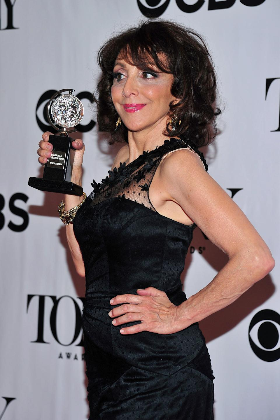 "Andrea Martin poses with her award for best features actress in a musical for ""Pippin"" in the press room at the 67th Annual Tony Awards, on Sunday, June 9, 2013 in New York. (Photo by Charles Sykes/Invision/AP)"