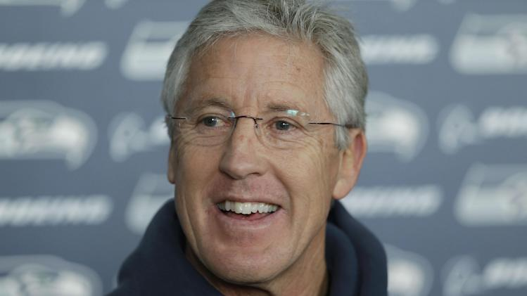 Seattle Seahawks head coach Pete Carroll talks to reporters after NFL